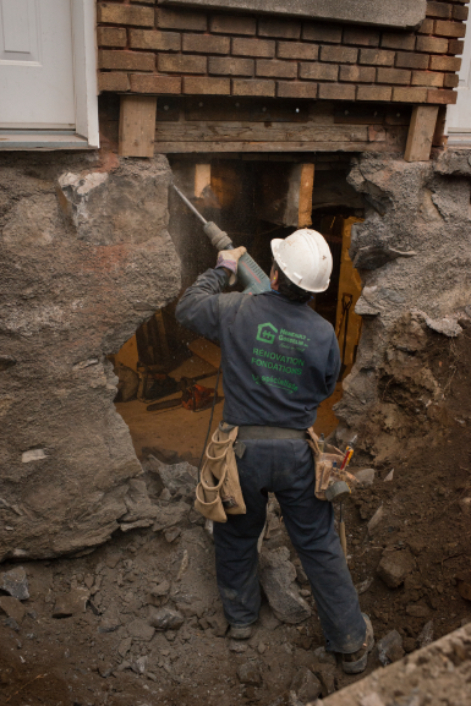 A worker creating an opening in the foundation